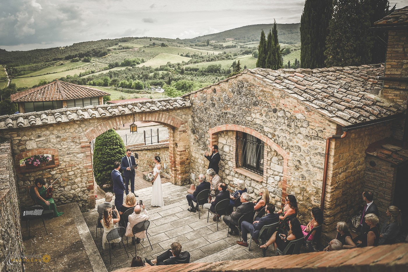 A panoramic photo with the beautiful Tuscan countryside in the background.