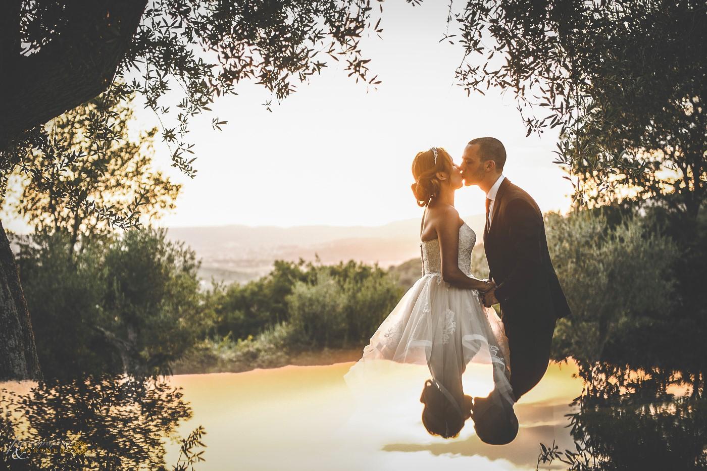 Romantic kiss at sunset.