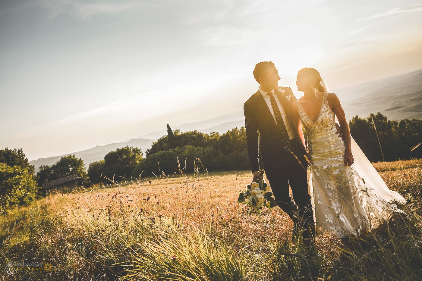 Romantic moment at sunset with the fantastic view of the Tuscan countryside
