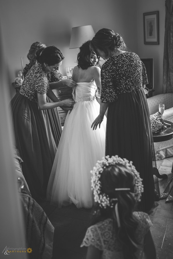 Closing of the bride's dress.