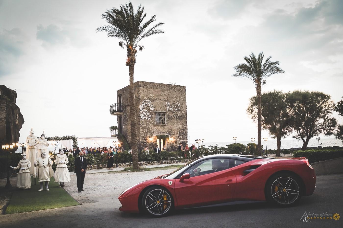 Errival at Torre Saracena of the Bride & Groom in Ferrari.